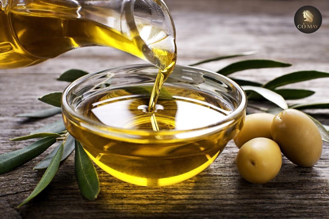 Làm cho tóc dày lên bằng olive